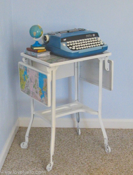 vintage blue typewriter and painted typewriter stand