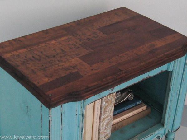 removing peeling veneer to reveal a beautiful wood strip top