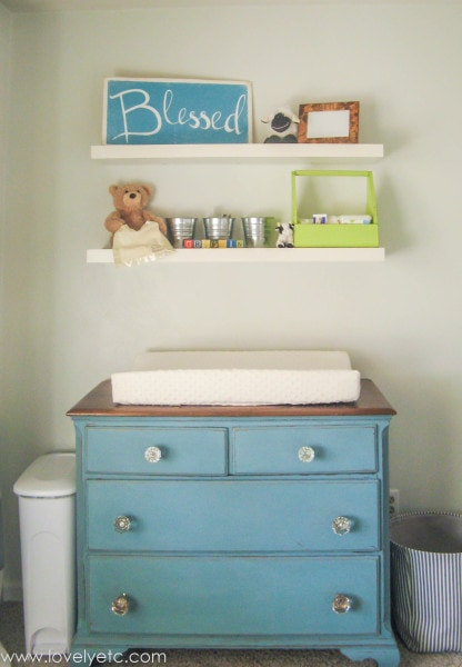 dresser and floating shelves in nursery