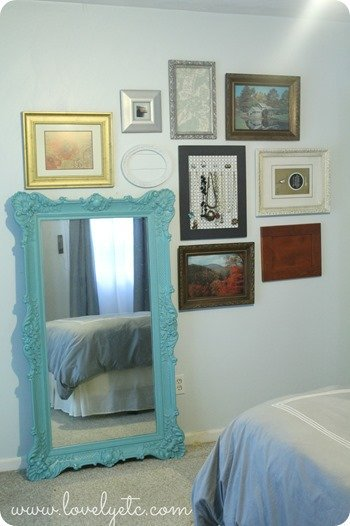 gallery wall around leaning mirror