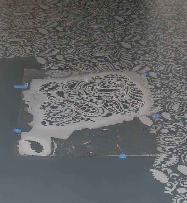 stenciling plywood floor with paisley stencil