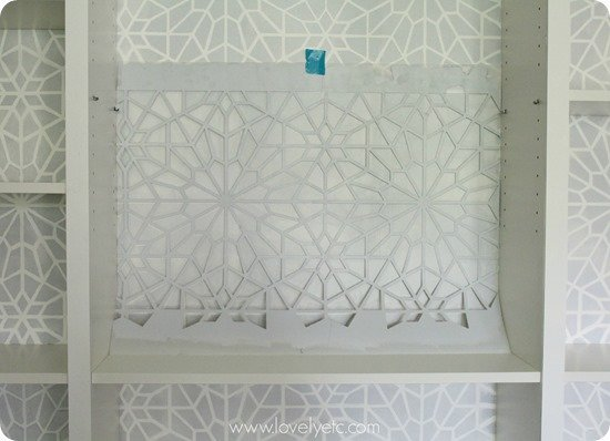 stenciling a bookcase backing