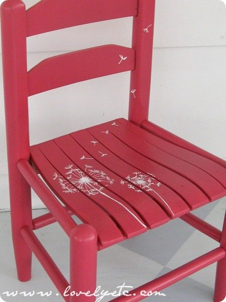 pink chair with dandelions painted