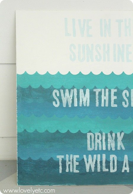 swim in the sunshine sign with waves