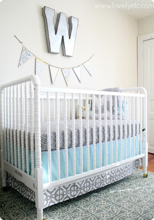 Aqua and gray nursery with patterned bedding