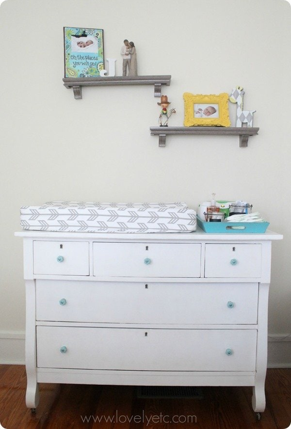 Painted dresser with aqua glass knobs