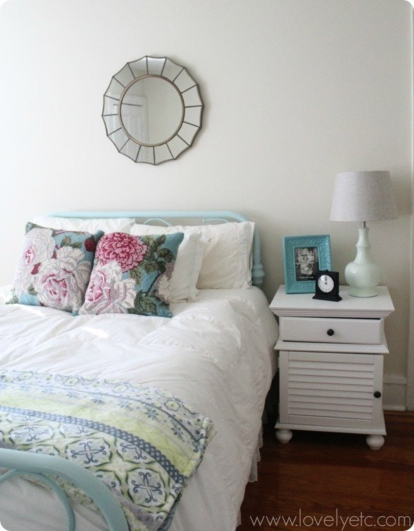 blue metal bed with white bedding