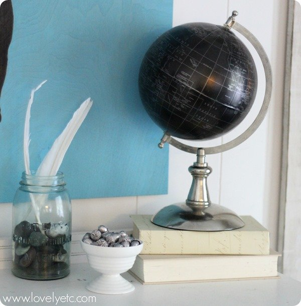 globe, silver acorns, feathers