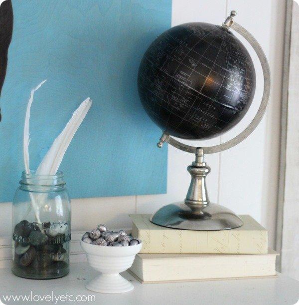 globe, silver acorns, feathers