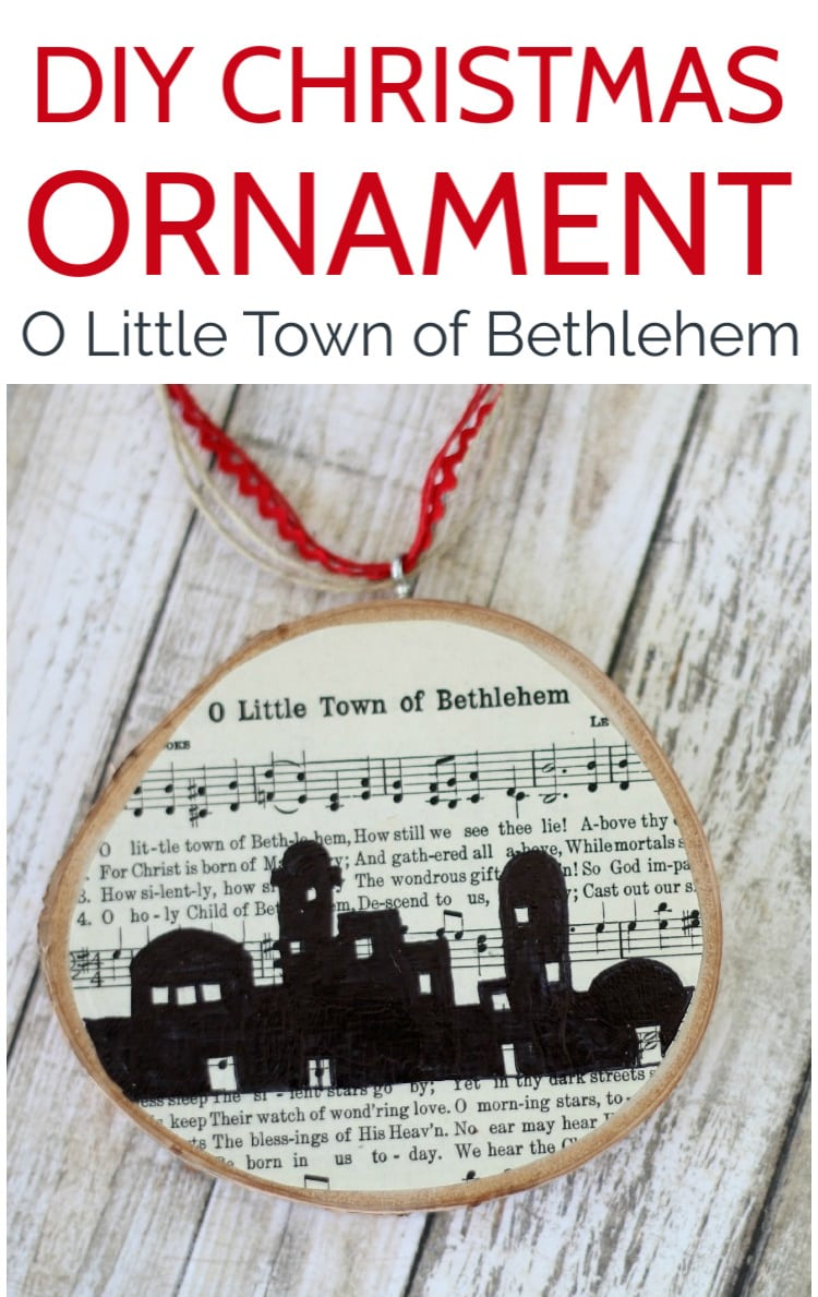 DIY Christmas Ornament with wood slice and free printable Christmas music to O Little Town of Bethlehem shown on wood background