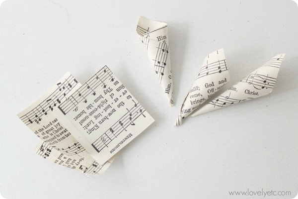 squares of sheet music rolled into tiny cones.