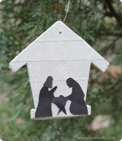 DIY ornament with stable background and silhouette of Mary and Joseph.