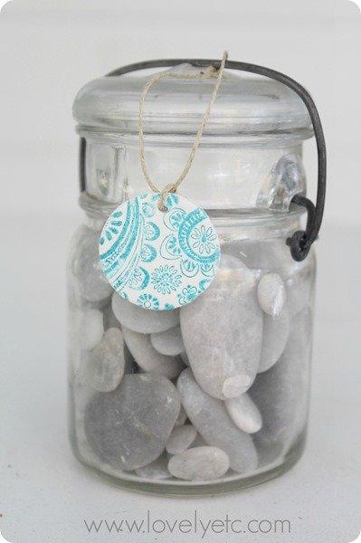 stamped clay tag on jar