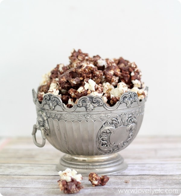 chocolate toffee crunch popcorn shown in silver bowl on table