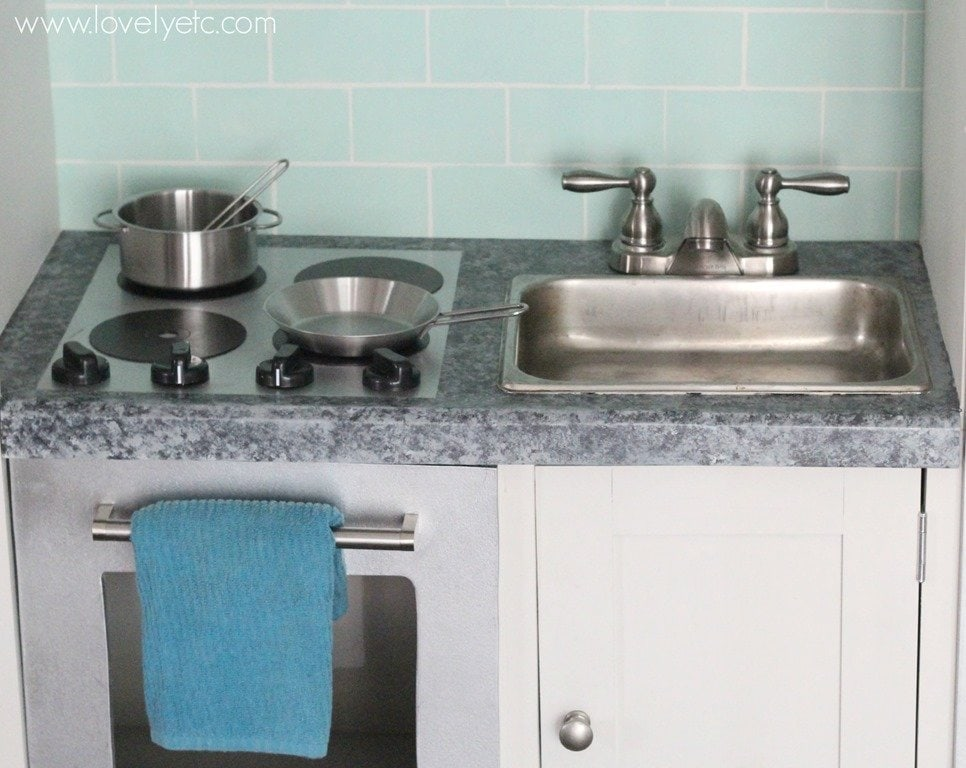 Diy play kitchen from an entertainment center lovely etc Realistic play kitchen