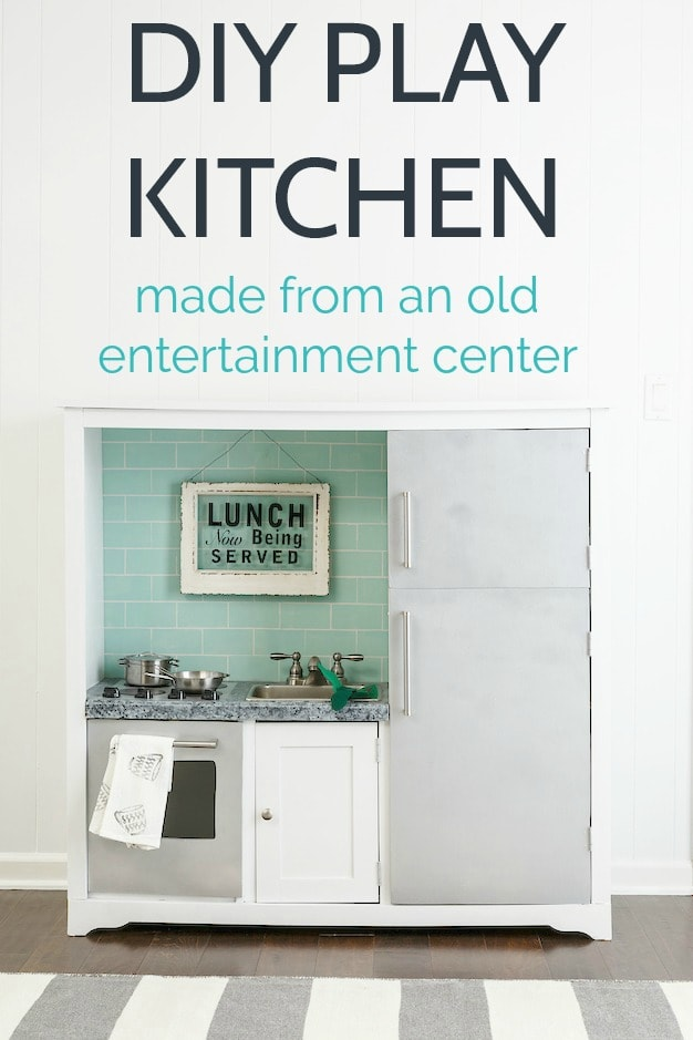 This inexpensive DIY play kitchen is made from an old entertainment center. Lots of fun details make it look like a real, miniature kitchen including a real faucet, a painted faux tile backsplash, and painted stainless steel appliances.