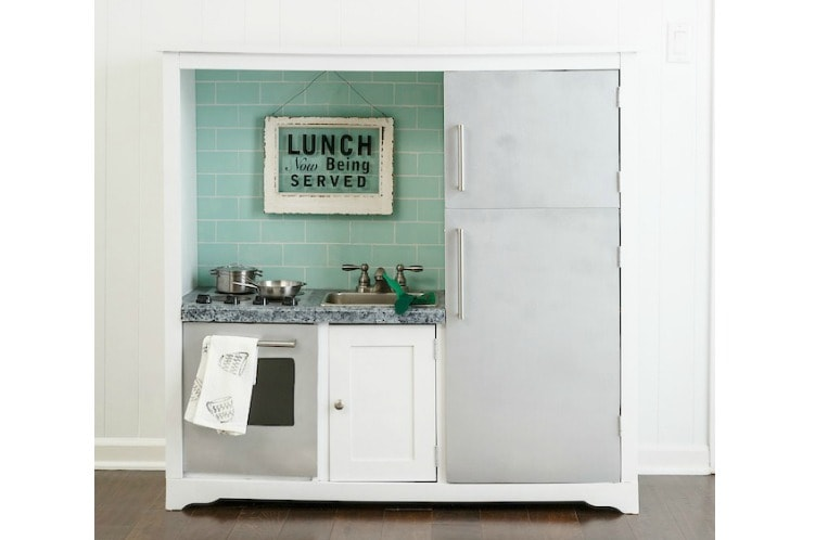 DIY play kitchen from an entertainment center - Lovely Etc.