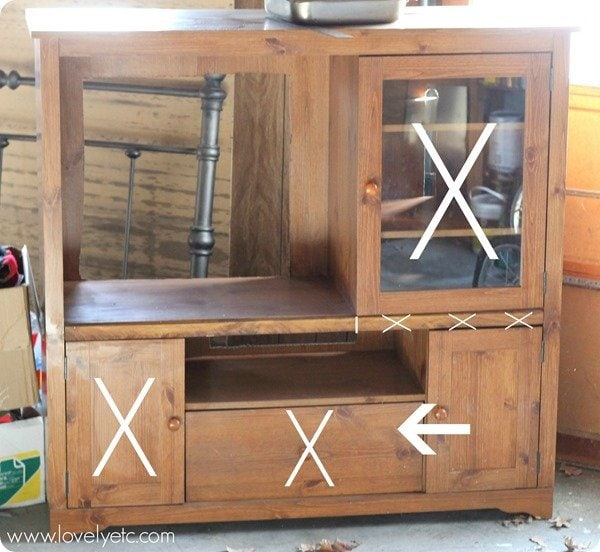 making over an entertainment center to become a play kitchen