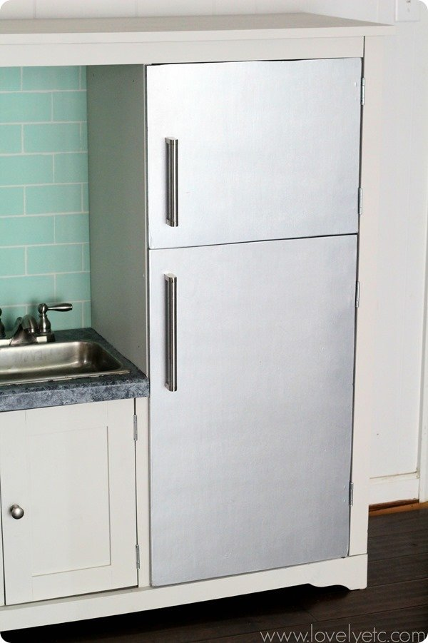 DIY play kitchen with stainless steel fridge - all it takes is some paint and Ikea handles