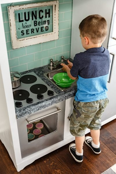 Fun DIY play kitchen made from an old entertainment center