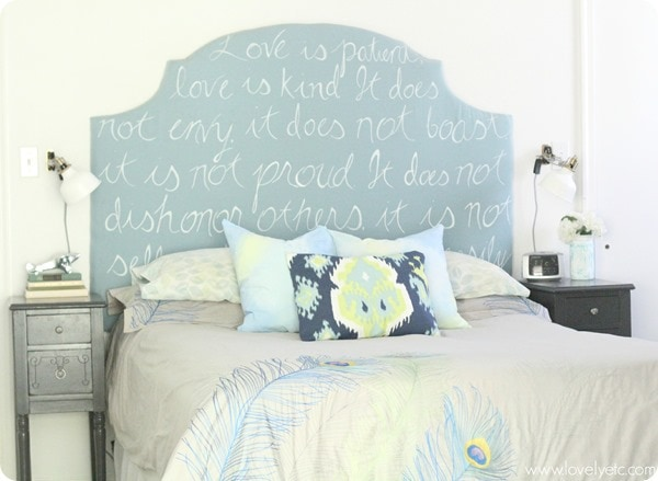 Bed with peacock bedding, ikat pillow, and DIY upholstered headboard