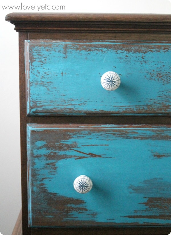 blue dresser with compass knobs
