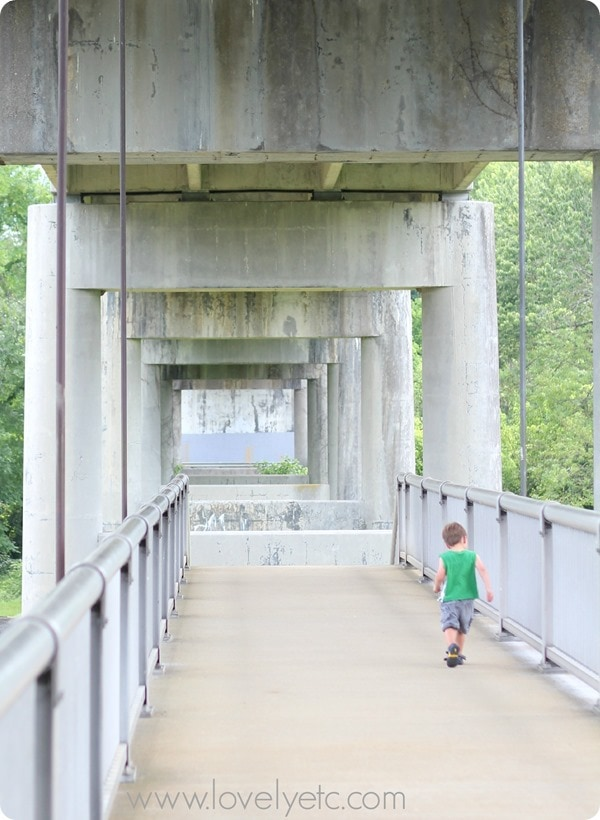 little boy crossing bridge