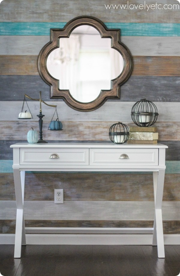 foyer with plank wall and quatrefoil mirror