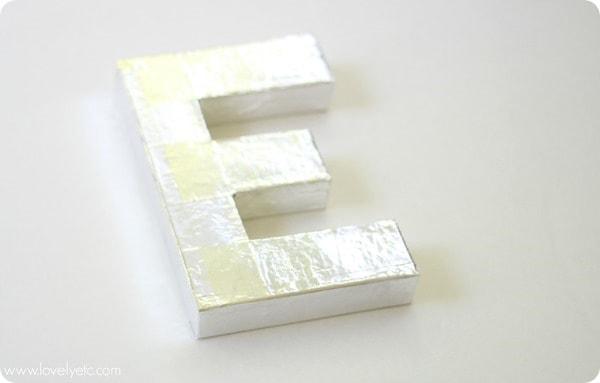 shiny metal letter