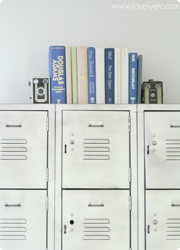 vintage camera bookends on top of metal lockers