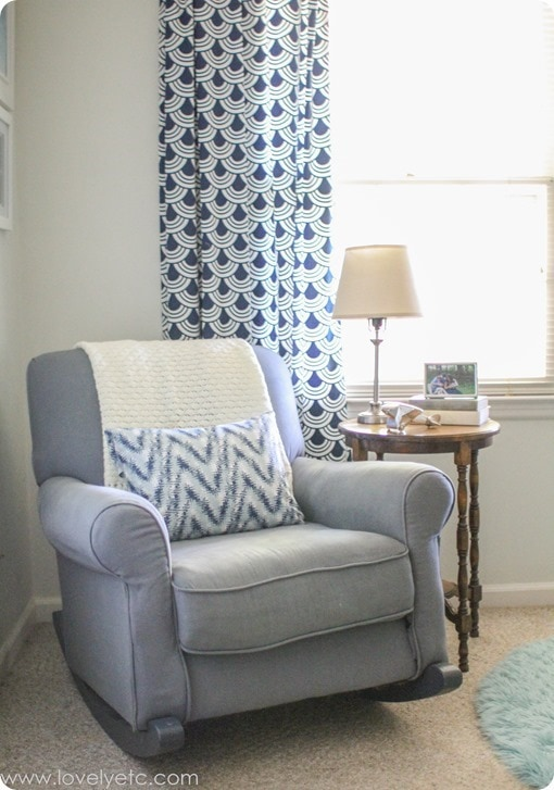 gray glider and navy curtains in nursery