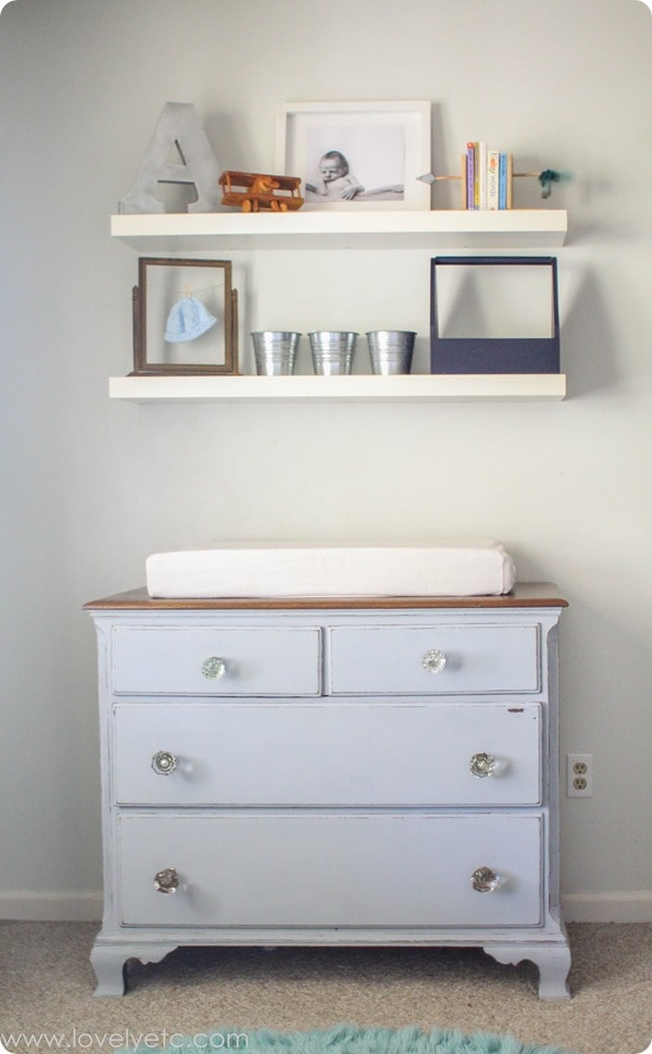 dresser with glass doorknobs and floating shelves
