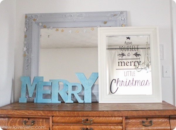bright light Christmas vignette - with letters spelling Merry and a mirror with vinyl that says Have yourself a merry little Christmas.