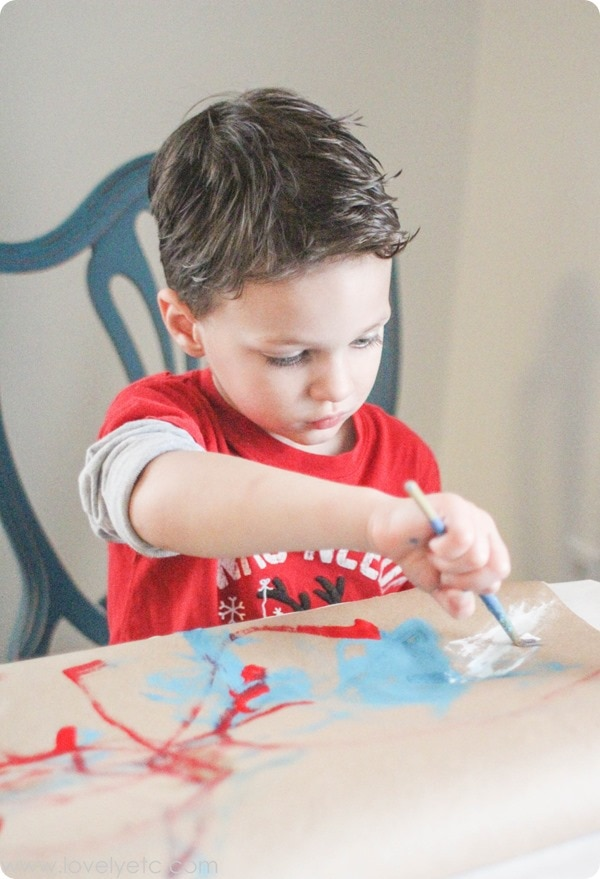 painting christmas wrapping paper with kids