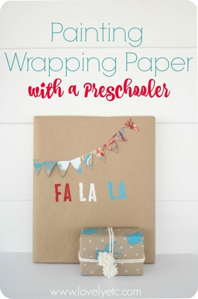 painting wrapping paper with a preschooler