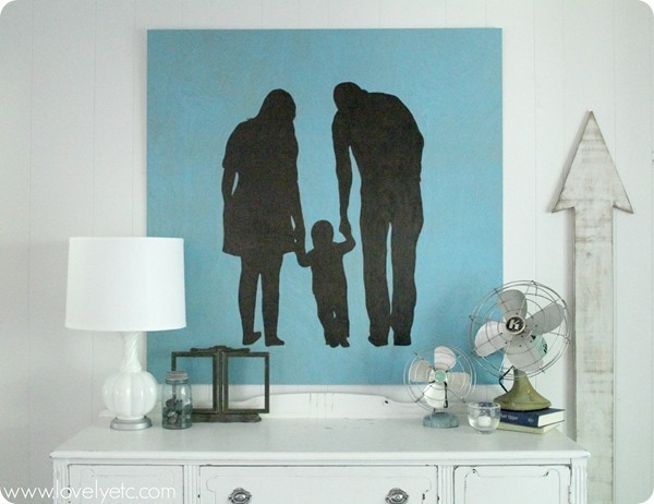 large painted family silhouette