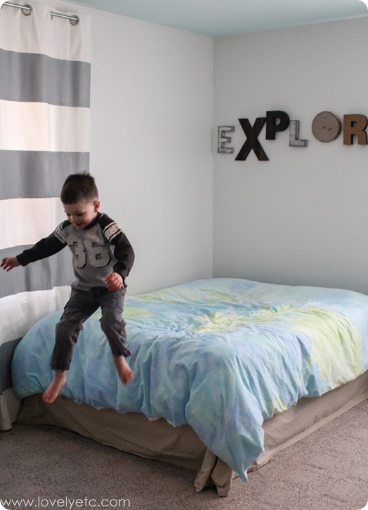 boy jumping off the bed