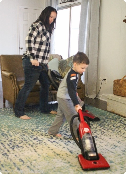 mom and son vacuuming together