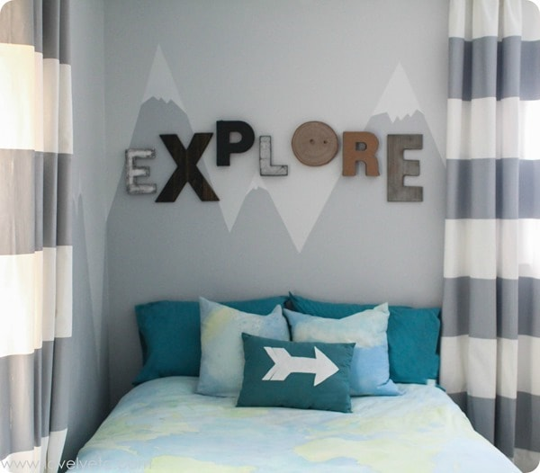 explore sign and mountain mural