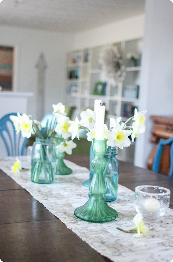 spring table with daffodils in mason jars and cheap table runner
