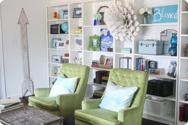 green chairs and bookcases