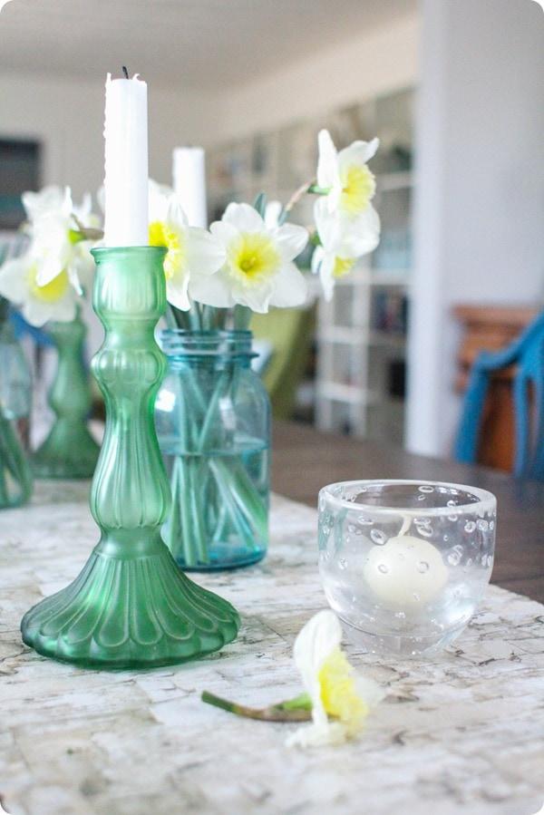 green candlestick and mason jar vase