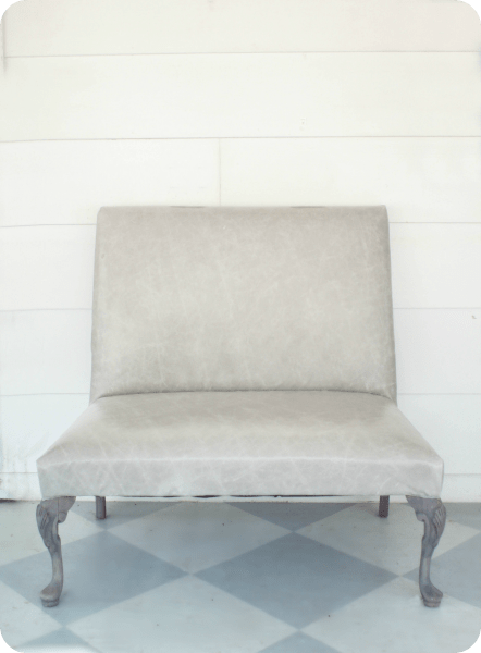 reupholstered leather settee