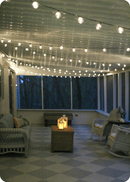 screened porch with string lights
