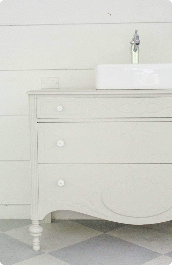 gray dresser with white hardware
