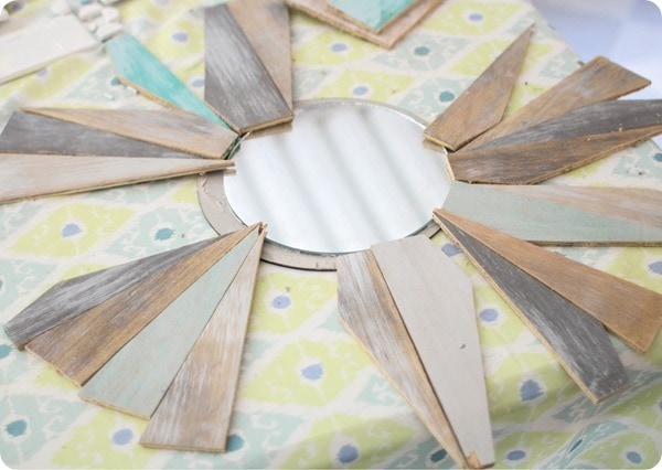 arranging wood to create a sunburst mirror