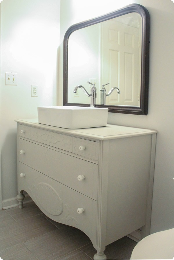 vintage mirror and dresser in bathroom