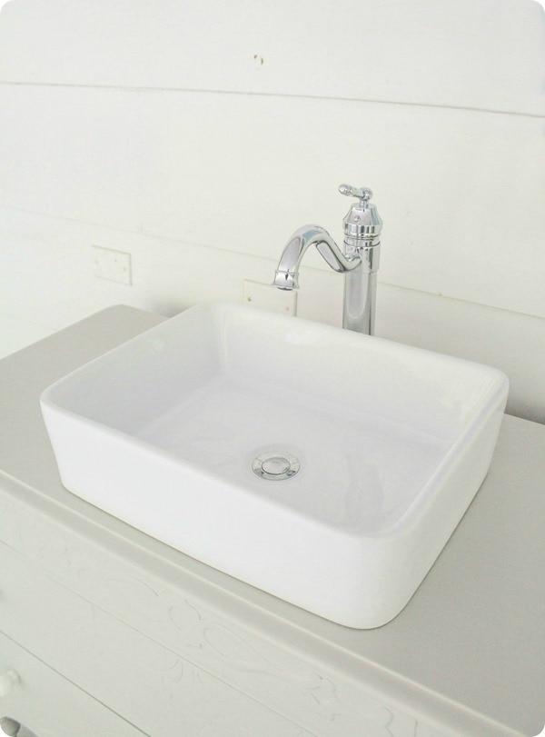 dresser vanity with white vessel sink
