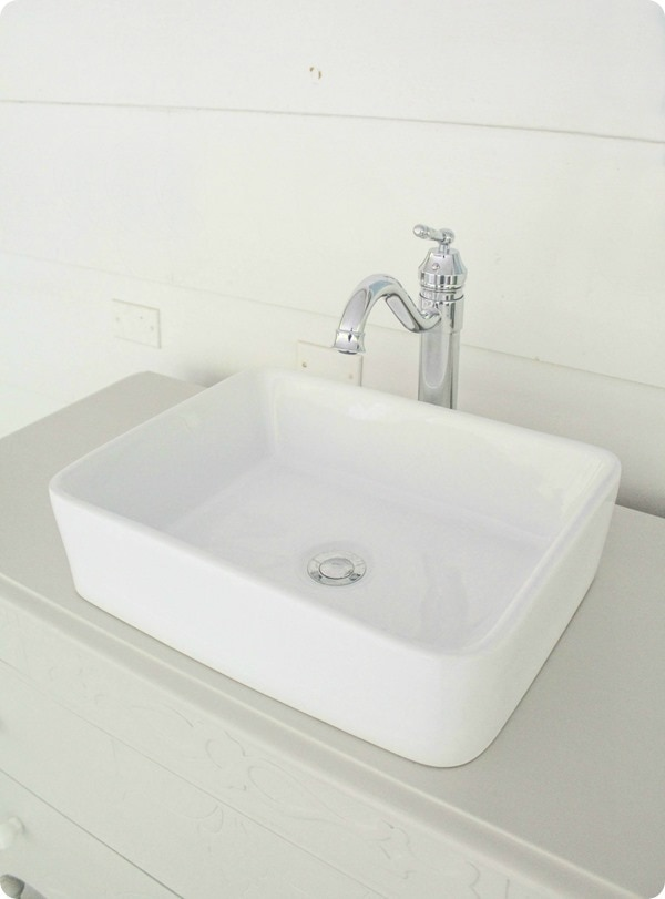 white rectangular vessel sink and chrome faucet