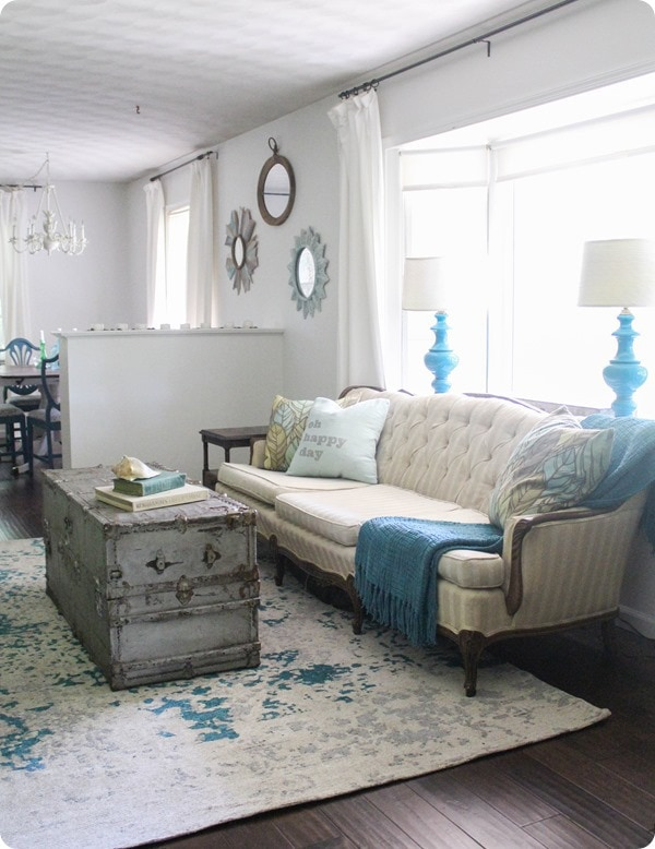 living room with vintage couch and trunk coffee table